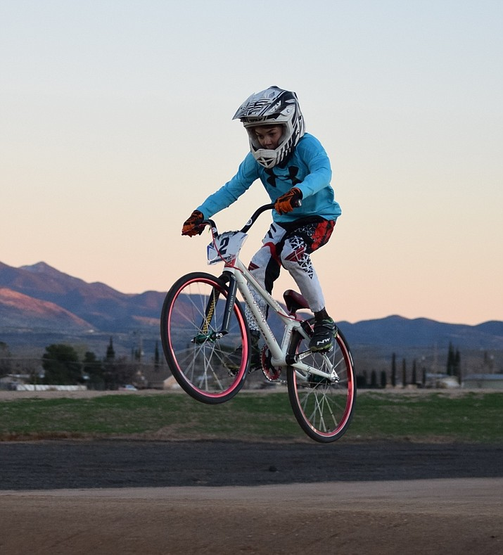 The Meins twins, both in the 8 Expert class, get airborne during Monday's High Desert 66 BMX racing at Mohave County Fairgrounds. Evan, in blue, sports the District 2 plate, and Eyan, right, rides around with the District 6 plate. BMX results from Monday are in today's Scoreboard.
