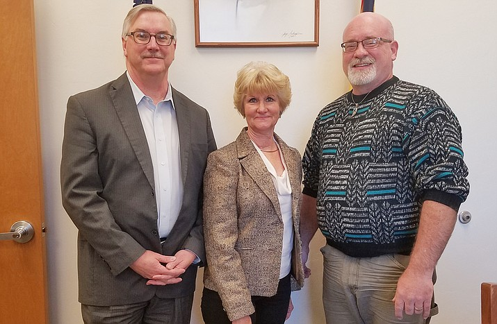 Yavapai County Education Foundation President Tim Wiederaenders (right) right welcomes new YCEF Board members Richard Heath and Jane Whitmire. (Courtesy photo)