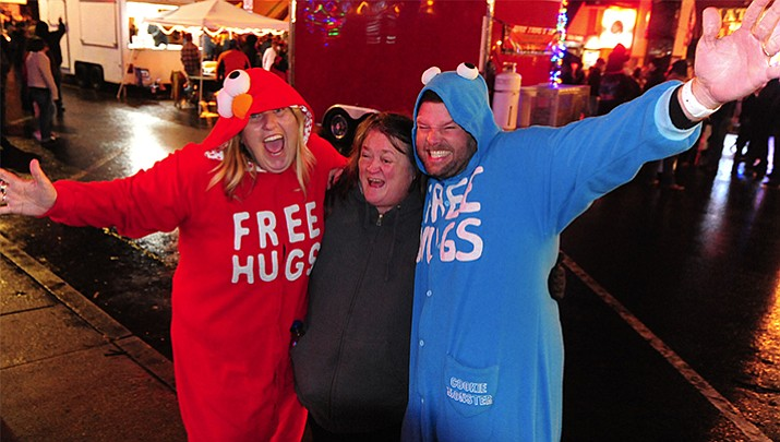 "Free hugs were offered at December's Whiskey Row Boot Drop in downtown Prescott. Time Magazine recently reported that Prescott has been designated one of the ""happiest and healthiest cities in America,"" – the only Arizona city in the top 20."