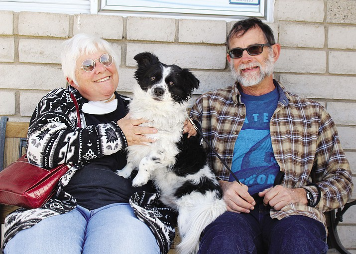Charlotte and Walt Kiffer of Dolan Springs sit at Wright Veterinary Clinic with Bullitt.