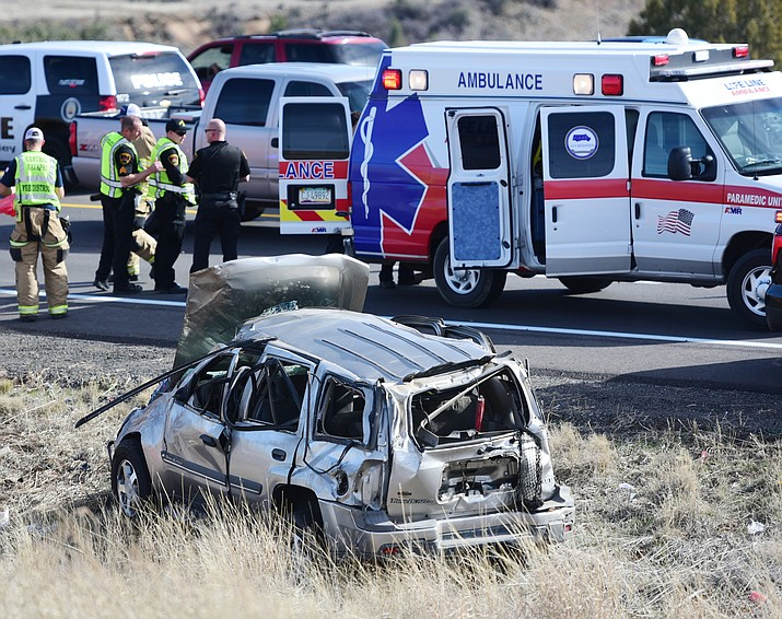 "Emergency personnel transport the second of two people from this single vehicle rollover on Highway 69 north of Enterprise Parkway in Prescott Valley Friday, March 10. ""Both were level one (most serious) and at least one of the victims was flown from the helicopter pad to a trauma center"" Central Arizona Battalion Chief Brad Davis said. (Les Stukenberg/The Daily Courier)"