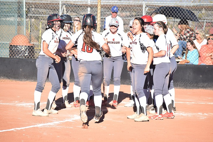 Mingus Union softball celebrates their walk-off win over Prescott on Thursday after junior shortstop/third baseman Nikki Zielinski's three-run home run. The Lady Marauders beat the Badgers 14-2 after losing in Presscott a couple days earlier. (VVN/James Kelley)