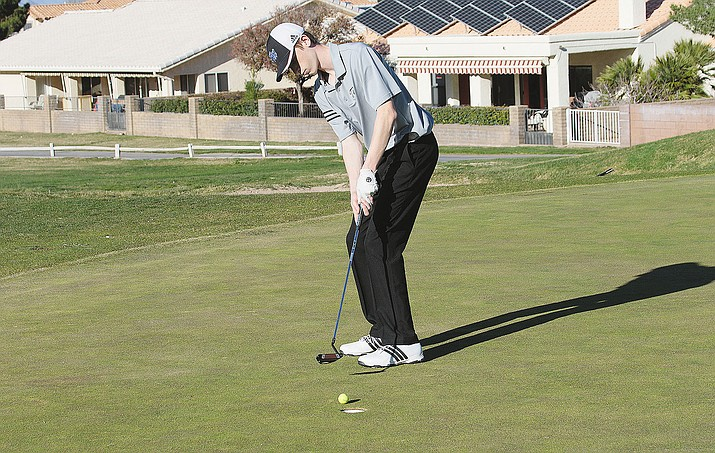 Kingman Academy golfer junior Jacob Heppler makes a shot on No.9  hole Thursday.