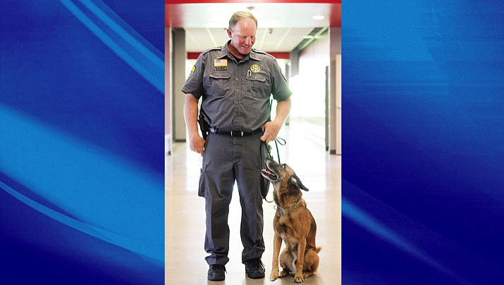 Deputy Schanaman with K-9 Officer Raidin at Lee Williams High School in 2012.