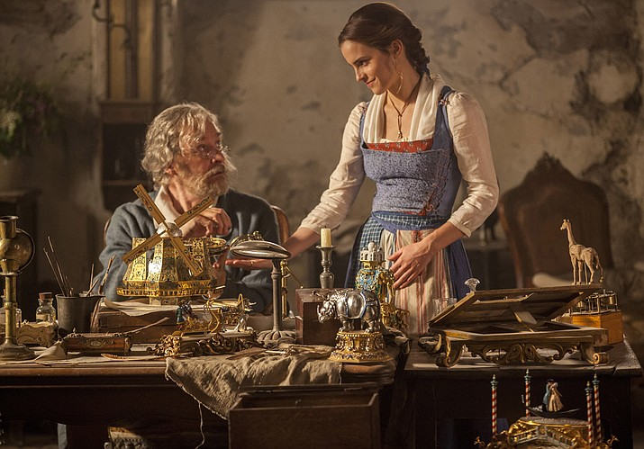 "This image released by Disney shows Emma Watson as Belle, right, and Kevin Kline as Maurice in a scene from ""Beauty and the Beast."" In the video below director Bill Condon and composer Alan Menken discuss the natural singing talent of the film's leads, Emma Watson and Dan Stevens."