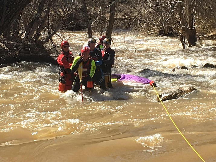 A 36-year-old woman is rescued by Yavapai's Backcountry Swift Water team. See video at dCourier.com.