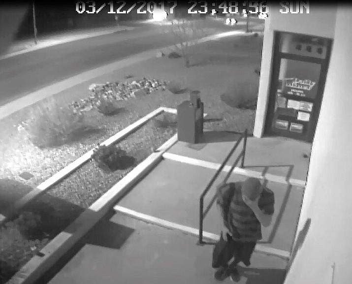The camera facing the front door at the Daily Miner captured this image of the suspect approaching from the south side of the building.