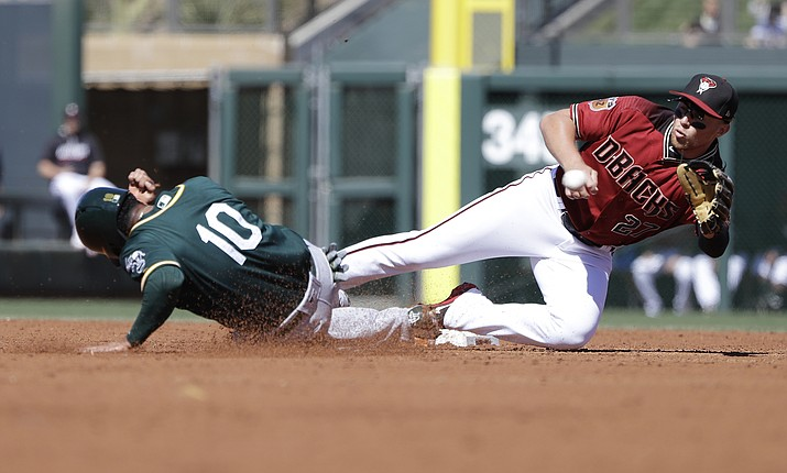 Oakland Athletics' Marcus Semien steals second as Arizona Diamondbacks' Brandon Drury reaches for the throw during the second inning of a spring training baseball game Tuesday, March 7, in Scottsdale.