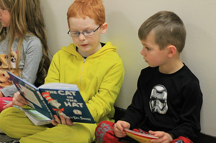 Williams middle school students read with elementary school students in the school's hallways to celebrate Dr. Seuss' birthday.