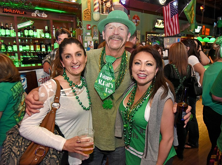 From left, Leah Webb, Ken Van Keuren, and Marlyn Summers gather together for a photo during the 2016 Prescott Pub Crawl downtown Prescott. The 2017 event begins at 3 p.m. at Far From Folsom, and continues through the 8 p.m. After Party at Matt's Saloon.