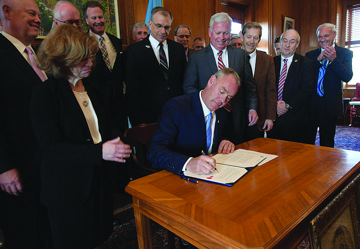 Zinke signs his first secretarial orders expanding access to public lands and eliminating a federal ban on lead ammunition in parks and wildlife refuges. Tami Heilemann/Creative Commons