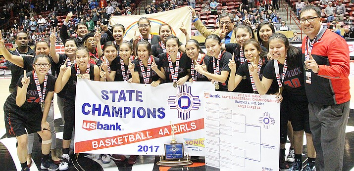 Shiprock Lady Chieftains Kylie McKinley, Danyel Johnson, Melanie Secody, Tiontai Woods, Tyana Harry, Paige Dale, Chamika Begaye, Tanisha Begay, Tierra Clichee, Kacy Begay, Tayya Dale, Evette Lansing, Lisa Begay and Coach Larenson Henderson celebrate their victory with Navajo Nation President Russell Begaye and Navajo Nation Vice President Jonathan Nez. Photo/Anton Wero