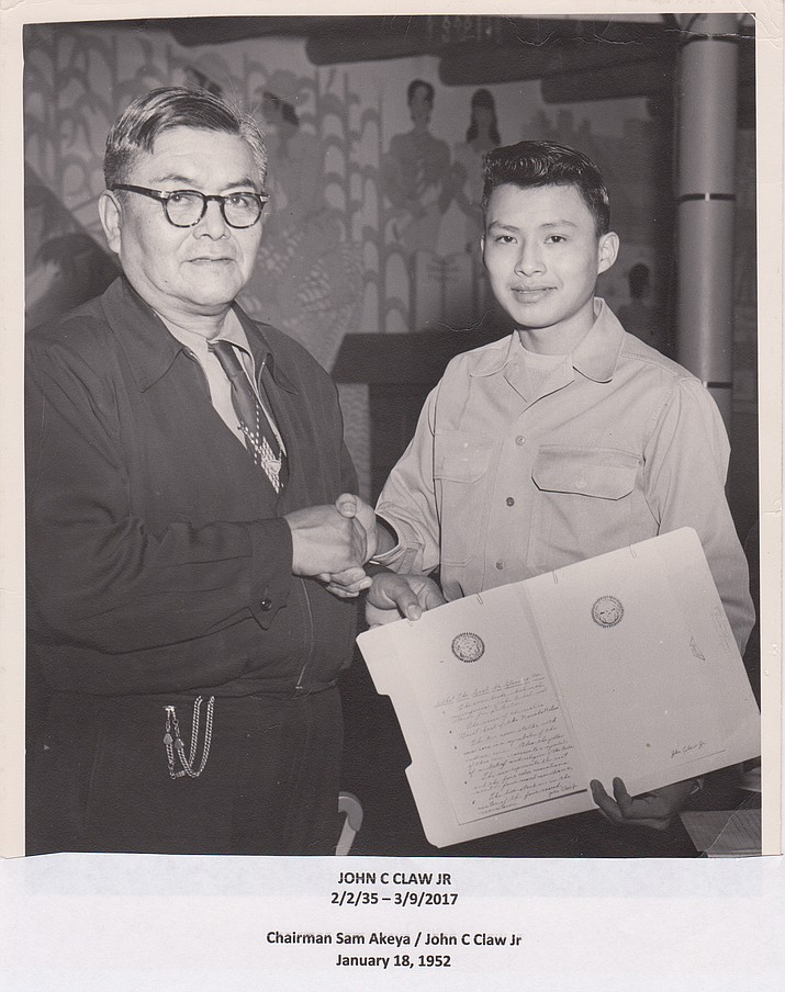 Navajo Tribal Chairman Sam Akeah shakes hands with a young John Claw Jr., in 1952 when his design became the Official Seal of the Navajo Nation. Submitted photo