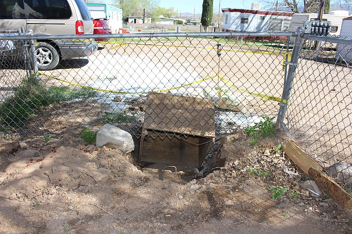 A sewage overflow in the yard of Elizabeth Pine and Tony Osborne at Coyote Canyon Mobile Home was investigated by Mohave County's Environmental Health Division Monday, and the owners of the park were issued a notice of violation and 24-hour notice to fix the problem.
