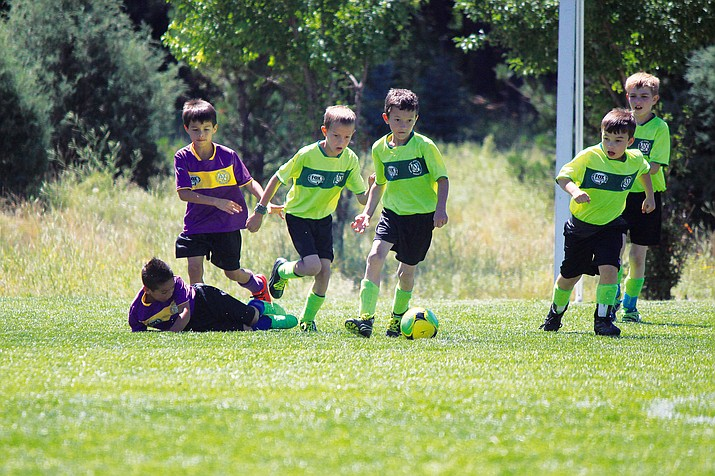 Cade Trimble, Brody Trimble, Ben Burlington and other Williams AYSO soccer players play a game against a Flagstaff AYSO team in June 2015.