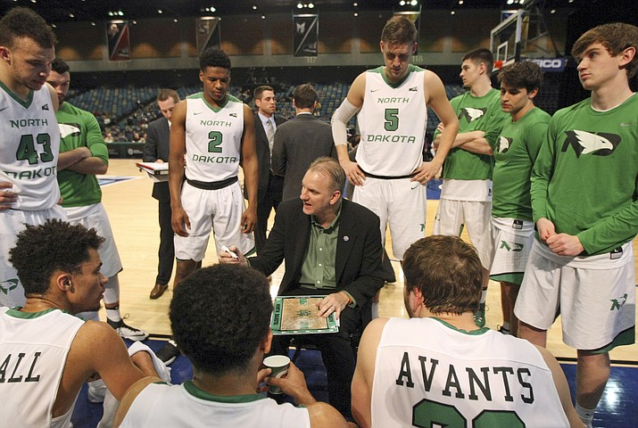 North Dakota coach Brian Jones talks to his team during the second half against Weber State in an NCAA college basketball game in the final of the Big Sky tournament in Reno, Nev., Saturday, March 11, 2017. (Lance Iversen/AP)