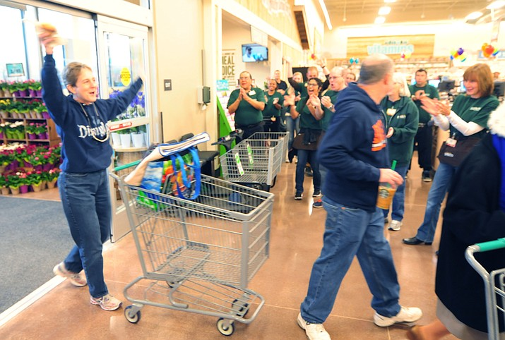 Shopper Terry Green celebrates the grand opening of Sprouts Farmers Market on Wednesday, March 15, in Prescott. More than 200 people lined up for the 7 a.m. opening. The first 200 received 20 percent off their purchases.