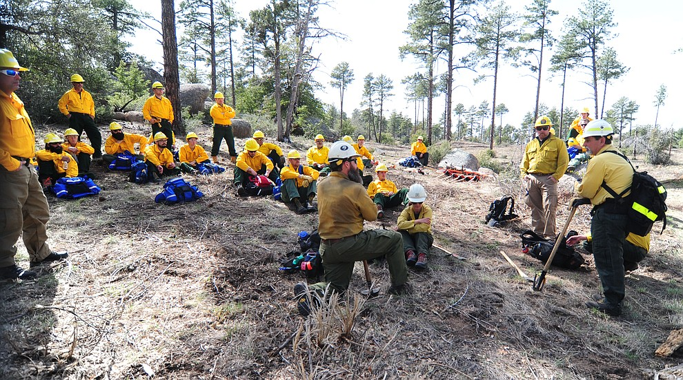 Safety Officer Don Muise talks to S130/190 Basic Wildland Firefighting students before they head out to cut line during the Arizona Wildfire Academy field day Wednesday, March 15 near the Iron Spring Road and Skyline Drive area in Prescott. (Les Stukenberg/The Daily Courier)