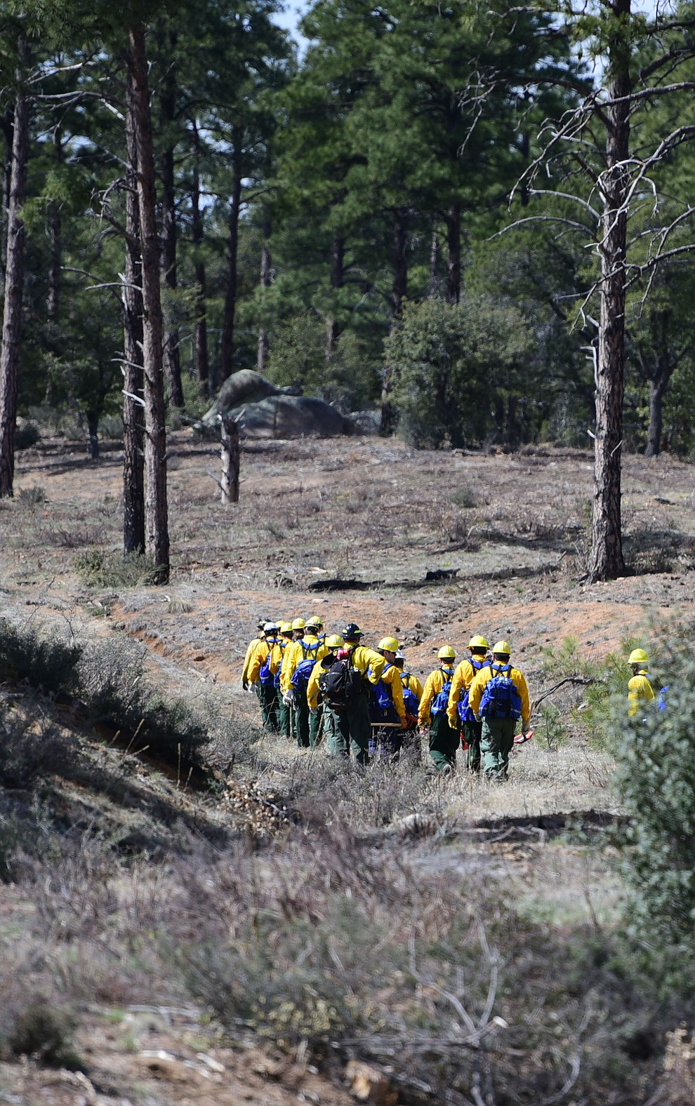 S130/190 Basic Wildland Firefighting students head out to cut line during the Arizona Wildfire Academy field day Wednesday, March 15 near the Iron Spring Road and Skyline Drive area in Prescott. (Les Stukenberg/The Daily Courier)