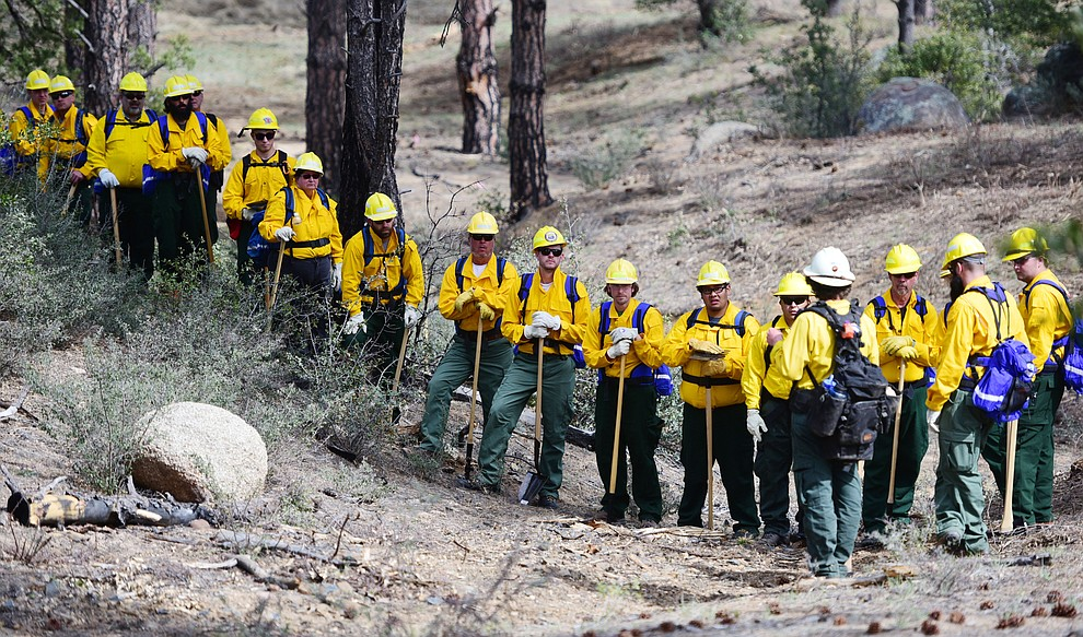 S130/190 Basic Wildland Firefighting students get a last minute briefing before they start to cut line during the Arizona Wildfire Academy field day Wednesday, March 15 near the Iron Spring Road and Skyline Drive area in Prescott. (Les Stukenberg/The Daily Courier)