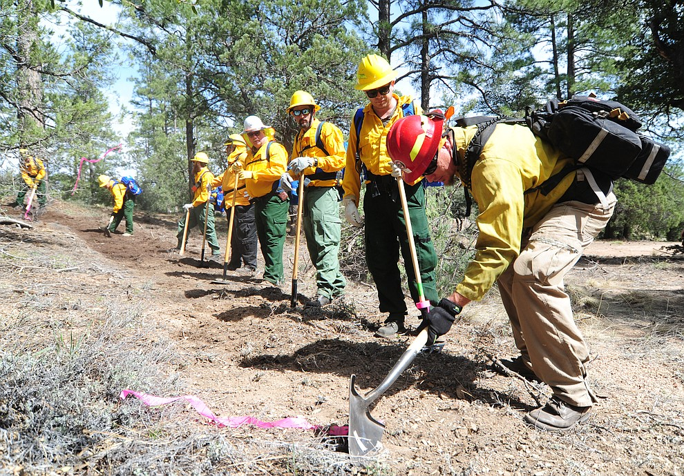 Arizona Department of Forestry & Fire Management Dustin Sciacca teaches students in the S130/190 Basic Wildland Firefighting students how to use a shovel to cut line during the Arizona Wildfire Academy field day Wednesday, March 15 near the Iron Spring Road and Skyline Drive area in Prescott. (Les Stukenberg/The Daily Courier)
