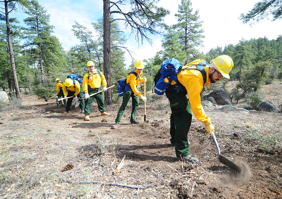 Prescott National Forest employee Francisco Anaya leads a group of S130/190 Basic Wildland Firefighting students cutting line during the Arizona Wildfire Academy field day Wednesday, March 15 near the Iron Spring Road and Skyline Drive area in Prescott. (Les Stukenberg/The Daily Courier)