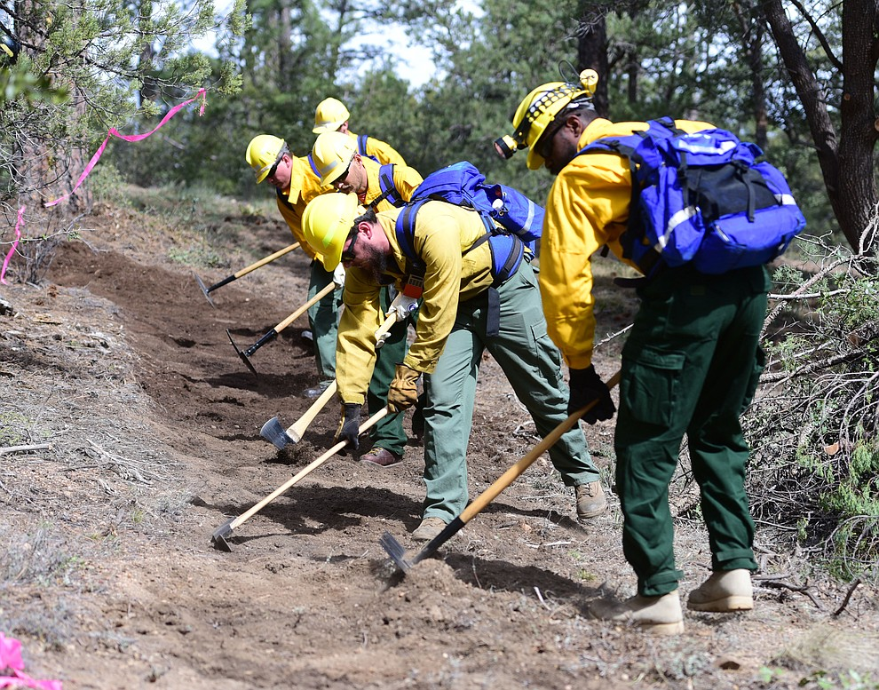 S130/190 Basic Wildland Firefighting students cut line during the Arizona Wildfire Academy field day Wednesday, March 15 near the Iron Spring Road and Skyline Drive area in Prescott. (Les Stukenberg/The Daily Courier)