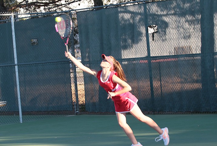 Kaylee Morley returns a shot against Barry Goldwater in tennis action Tuesday.