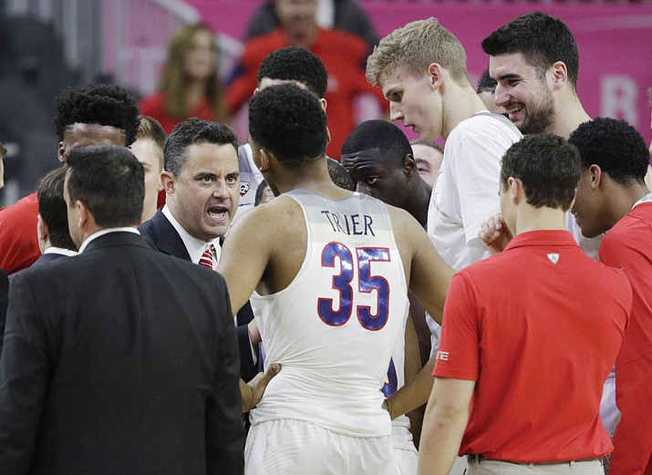 Arizona coach Sean Miller speaks with his players during the second half of an NCAA college basketball game against UCLA in the semifinals of the Pac-12 men's tournament Friday, March 10, 2017, in Las Vegas. Arizona won 86-75. (AP Photo/John Locher)
