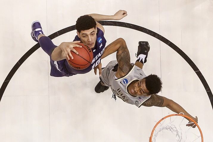 Kansas State's Isaiah Maurice, left, and Wake Forest's John Collins, right, battle for a rebound in the first half of a First Four game of the NCAA college basketball tournament, Tuesday, March 14, 2017, in Dayton, Ohio. (John Minchillo/AP)