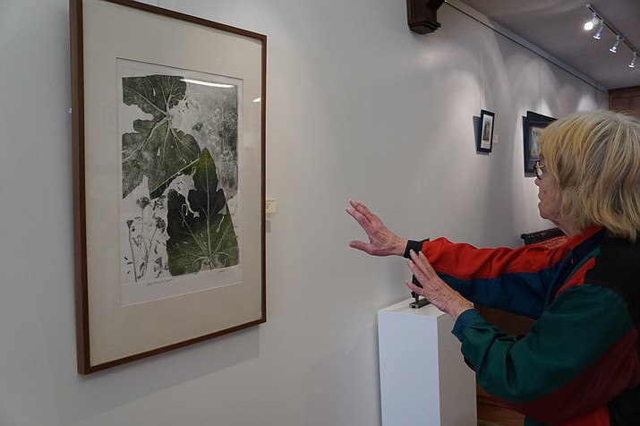 "'Tis Gallery Host Judith Skinner describes the techniques used by local artist Saveria Judge in the monoprint, ""Pumpkin Leaves & Garlic Chives."" The piece is a part of 'Tis Gallery's ""Making Our Mark 2017 Contemporary Printmakers of Prescott"" exhibit, which continues through Tuesday, March 21."