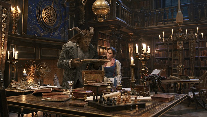 "The Beast (Dan Stevens) and Belle (Emma Watson) in the castle library in Disney's ""Beauty and the Beast,"" a live-action adaptation of the studio's animated classic, a celebration of one of the most beloved stories ever told."