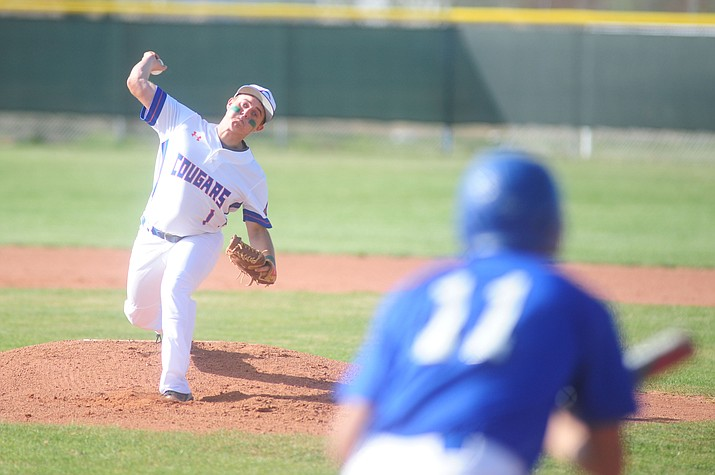 Chino Valley's Skylar Brooks delivers a pitch to Michael Mendez as the Cougars take on the Bagdad Sultans Friday, March 17 in Chino Valley. (Les Stukenberg/The Daily Courier)
