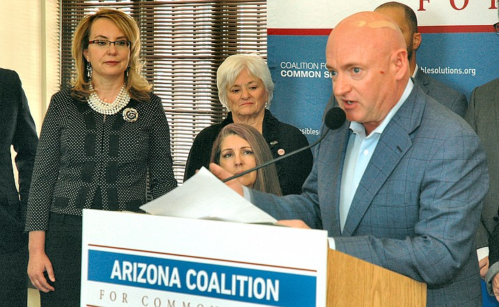With wife Gabrielle Giffords looking on Thursday, husband and former astronaut Mark Kelly details the launch of an Arizona coalition to push for what he said are more sensible gun laws. (Capitol Media Services photo by Howard Fischer)