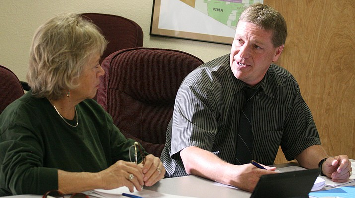 """Bob Weir, right, superintendent of Valley Academy of Career and Technical Education, says auditor Heinfeld, Meech and Company, Ltd. """"came highly recommended by several districts. They are very thorough and offer a lot of support and [they] help the district go in the right direction."""" (Photo by Bill Helm)"""
