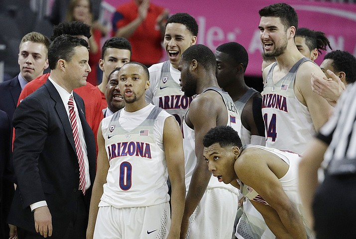 Arizona coach Sean Miller, left, speaks with his players during the second half of an NCAA college basketball game against UCLA in the semifinals of the Pac-12 men's tournament Friday, March 10, 2017, in Las Vegas. Arizona won 86-75. (AP Photo/John Locher)