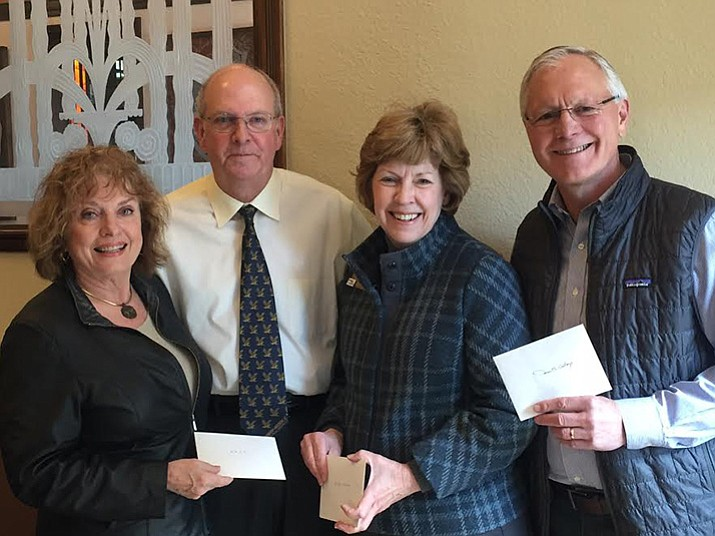 P.E.O. Chapter Y President Leslie Ross, (left) presents scholarship awards to the three Prescott area college presidents, L to R – Dr. Frank Ayres, Chancellor of Embry Riddle University; Dr. Penny Wills, President of Yavapai College and John Flicker, Prescott College President.