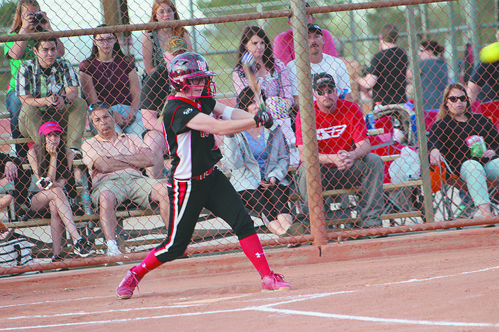 Kera Mertens records a base hit Friday during first-day action of the Swire Coca-Cola tournament at Centennial Park.
