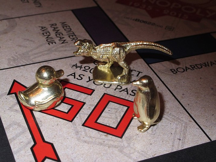 Fans from around the world have voted three new tokens into upcoming editions of the board game Monopoly: a duck, a T-Rex dinosaur and a penguin. Hasbro Inc. revealed the results of voting on Friday, March 17, 2017. Leaving the game will be the boot, wheelbarrow and thimble tokens.