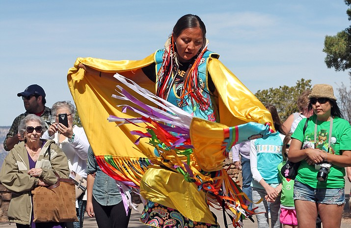 A Pollen Trail dancer demonstrates the Fancy Shawl Dance, a social powwow dance representing the arrival of spring.