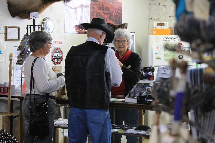Fayrene Hume helps visitors at the Ash Fork Museum Mar. 8.