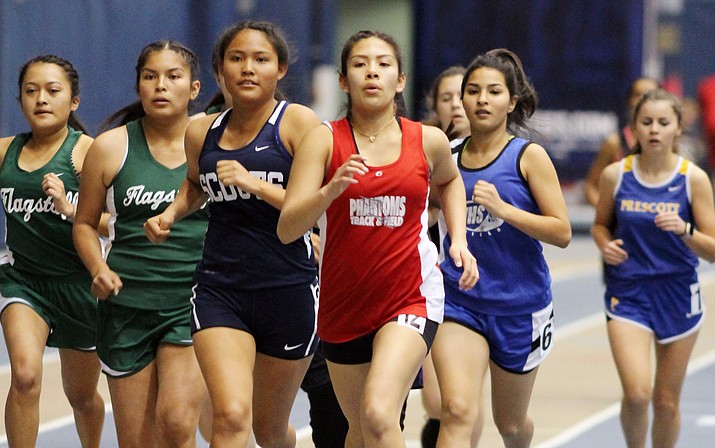 Mariela Montano leads a pack of runners in the 800 meter race.