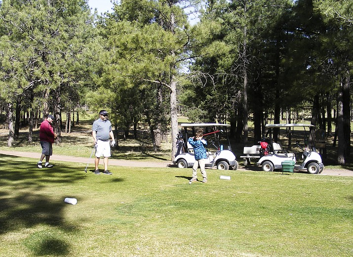Local golfers enjoy a round of golf at Elephant Rocks Golf Course.