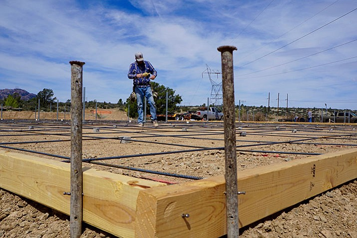 Jared Dinco of McIntosh Concrete Contracting works to prepare the metal rebar at the new pickleball courts at Pioneer Park before the application of the concrete.