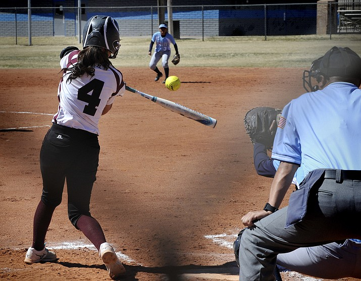 The Winslow Lady Bulldogs beat the Window Rock Lady Scouts 9-3, March 14. Alicia O'Haco with a hit. Photo/Todd Roth