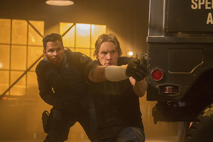 "This image released by Warner Bros. Pictures shows Michael Pena, left, and Dax Shepard in a scene from, ""CHiPS."""