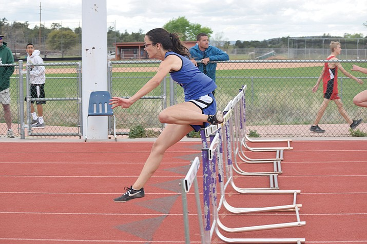 Camp Verde senior Alana Neary clears the last hurdle in the 100m hurdles at the Friendship Invitational at Sedona Red Rock on Wednesday. Neary took third in the 100m hurdles and fourth in the 300m hurdles. (VVN/James Kelley)