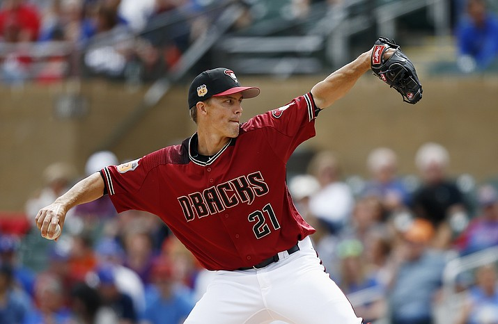 Arizona Diamondbacks' Zack Greinke throws a pitch against the Chicago Cubs during the first inning Thursday in Scottsdale. (Ross D. Franklin/AP)