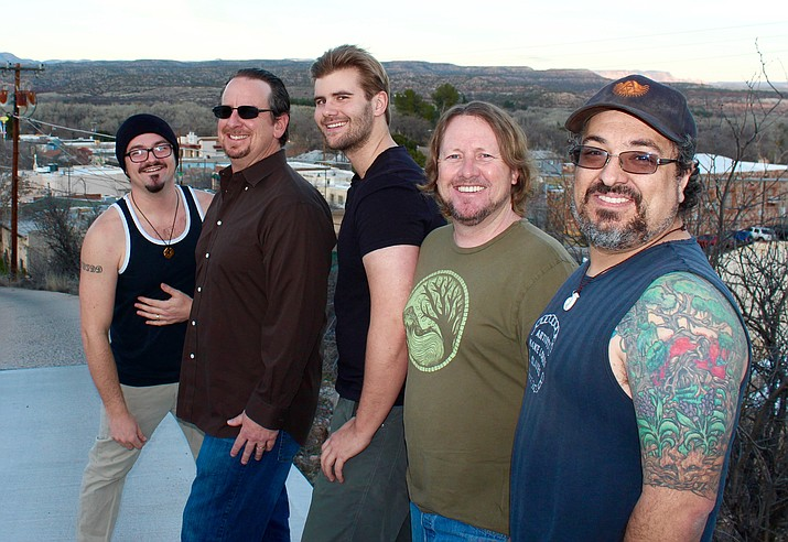 Keith Okie and Rebel Sol perform at the Birdcage Saturday, March 25.
