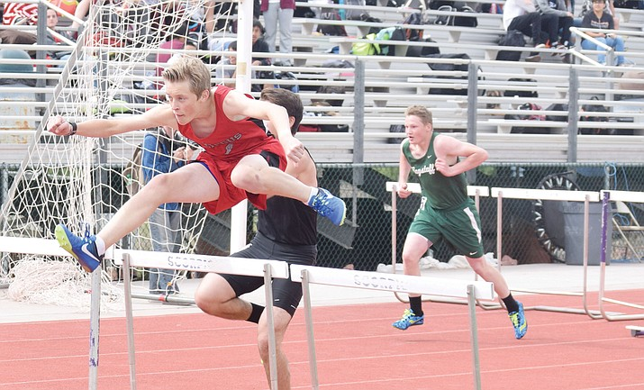 Mingus Union freshman Chance Densmore jumps over a hurdle at the Friendship Invitational at Sedona Red Rock on Wednesday in the 110m hurdles. The Friendship Invite was Densmore's second meet competing in the 110m hurdles at the high school level. (VVN/James Kelley)